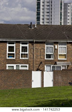 LONDON, UNITED KINGDOM - SEPTEMBER 12 2015: Row of British brick house in the periphery of London