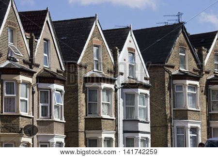 LONDON, UNITED KINGDOM - SEPTEMBER 12 2015: Traditional English terraced house in a row in Woolwich Arsenal London district