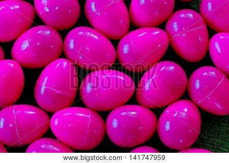 background of multicolored plastic Easter eggs .