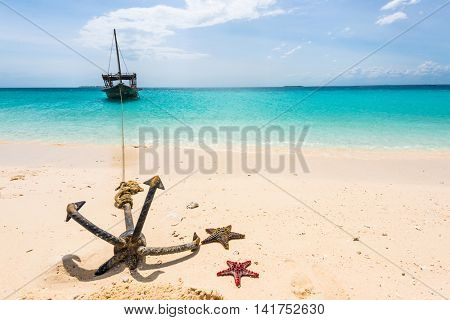 anchor with starfish and boat on the background of blue ocean and sky