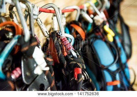 different climbing equipment, carabiners and ropes closeup
