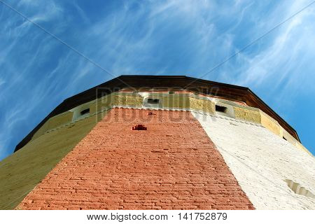 Watch tower of Spaso-Prilutsky Monastery in the Vologda city, Russia. Blue sky and castle defense wall tower. Unusual view