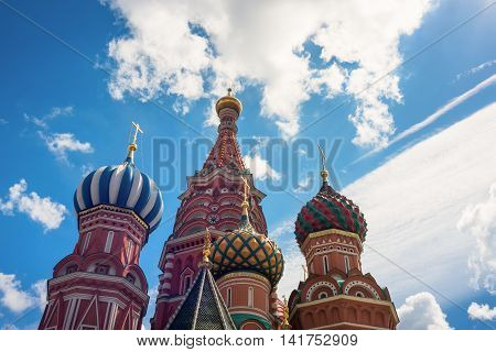 dome of St. Basil's Cathedral on the background of blue sky and clouds