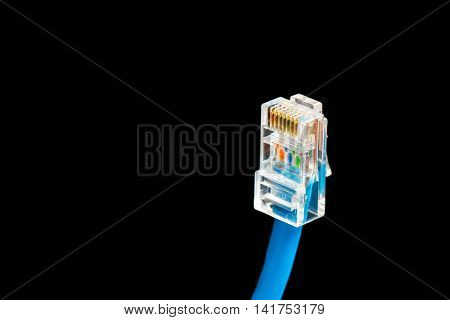 Blue computer ethernet cable isolated on black background closeup