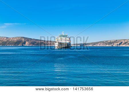Passenger ferry boat between islands of Cres and Krk on Adriatic sea in Croatia