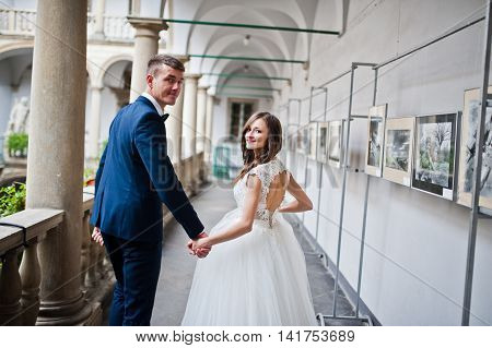 Wedding Couple On The Old Italian Courtyard