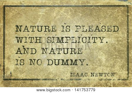 Nature is pleased with simplicity - ancient English physicist and mathematician Sir Isaac Newton quote printed on grunge vintage cardboard poster
