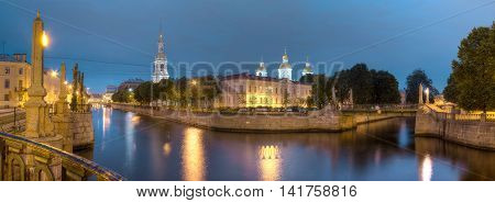 Night view on illuminated Kryukov Canal Griboedov Canal and St. Nicholas Naval Cathedral St. Petersburg Russia poster