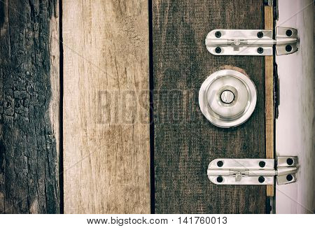 Old Lock On The Door Of An Old Farmhouse . True Village Style . Close-up. Focus On Lock.