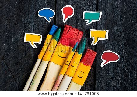 Five art brushes like a toy family with smiley faces talking. Chat bubbles  are colored in different color.