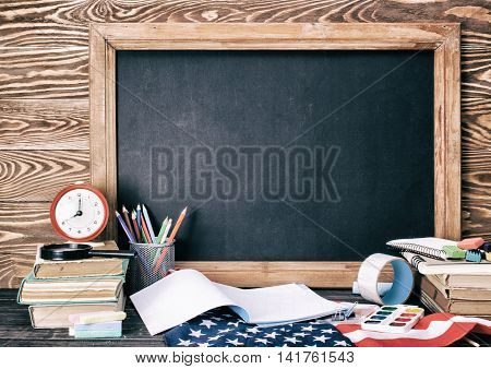 School Board And Stationery On Wooden Table.