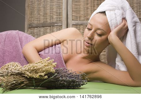 stock photo attractive lady getting spa treatment in salon, massage doctor smiling care pretty close up