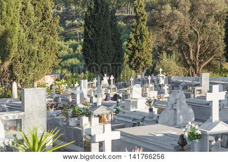 CRETE, GREECE - APRIL 21. Greek orthodox cemetery in the village Kamilari in the south-central of Crete on April 21, 2016. The greek orthodox is inhume in stone coffin