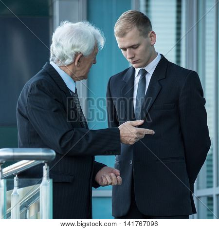 Boss Talking With Young Worker