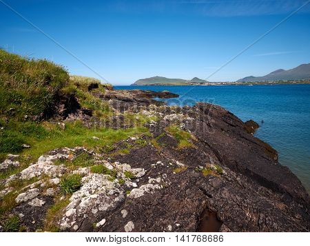 Rocky coastline in Dingle, Ireland, on a sunny day