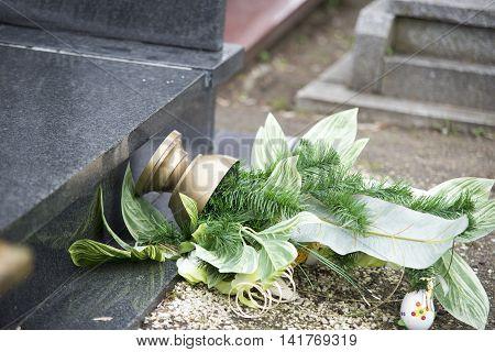 Close Up On Broken Flowers On The Gravestone