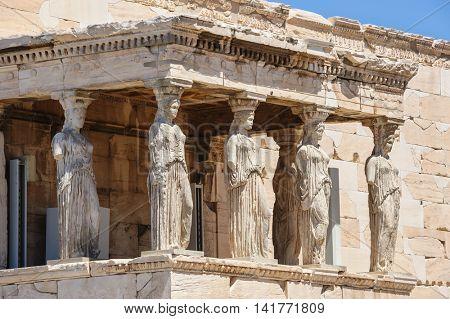 Six Caryatids or karyatides at Porch of the Erechtheion in Acropolis at Athens. poster