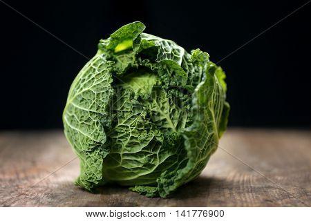 Savoy cabbage on dark background