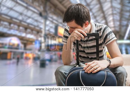 Delayed Train Concept. Tired Passenger Is Sitting In Train Stati