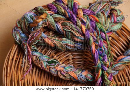 Embroidery threads of every color on brown background