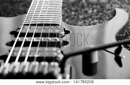 black and white microphone of vintage electric guitar