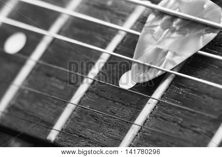 Black And White Pick And Vintage Electric Guitar