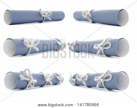 Blue paper rolls tied with natural ropes and bows isolated