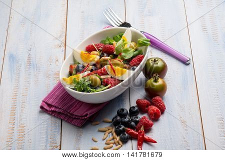 mixed salad with boiled egg raspberry blueberry and tomatoes