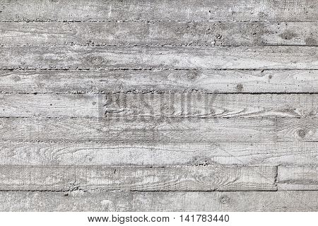 Wall made of concrete with wood texture. texture of wooden formwork on the concrete wall