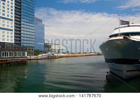 BOSTON,MASSACHUSETTS,USA - JULY 15,2016:Tourist ship in harbor. Boston tourism annually brings about 8 billion dollars