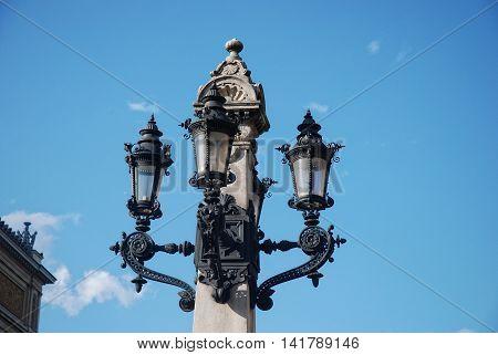 old lantern at Opernplatz in Frankfurt , Germany poster