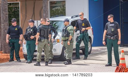 Daytona Beach, FL - August 3, 2016: Police officers gather to provide security at the Donald Trump rally in Daytona Beach, FL.