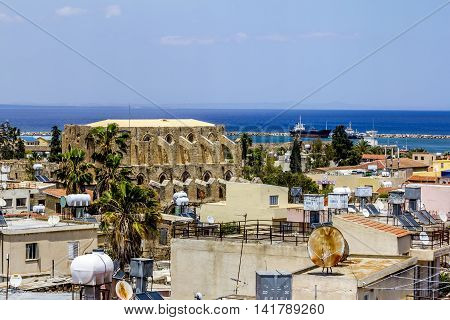 May 24 2016.Famagusta.The roofs of the houses and The Church of Peter and Paul in the old town of Famagusta .Northern Cyprus.