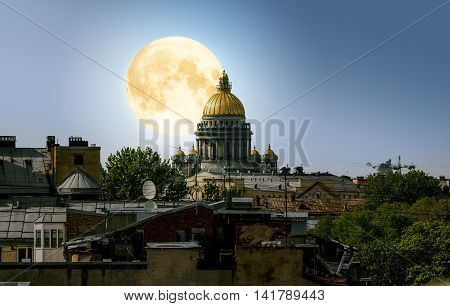 13 may 2016.Sain-Petersburg.The full moon over Saint Isaac's Cathedral and the city centre during the white nights in St. Petersburg.Russia.