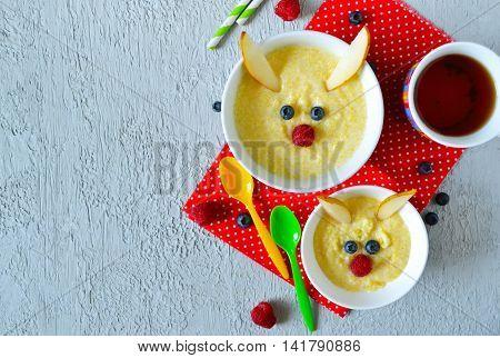 Breakfast for children porridge with berries and fruits