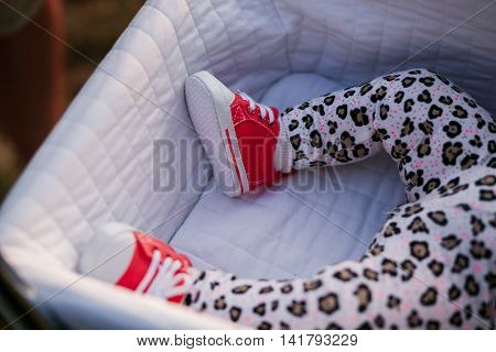 Little baby girl sleeping in baby carriage