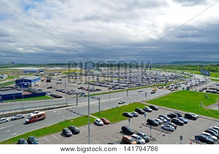 ST PETERSBURG RUSSIA - MAY 11 2016. Airport auto parking. View from the height of airport auto crowded parking lot in Pulkovo International airport in St Petersburg Russia