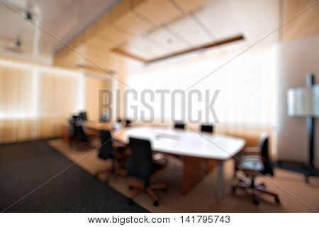 Businessmen blur in the workplace.Table Top And Blur Office of Background.abstract blur background table work in office with computer.Abstract background of office, shallow depth of focus.