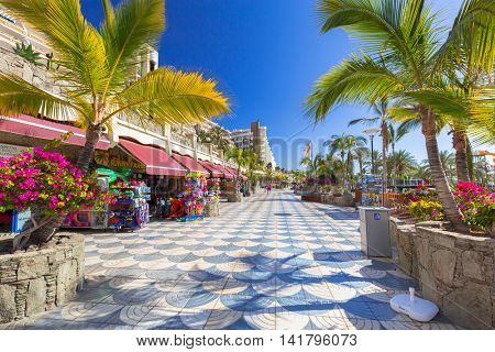 TAURITO, GRAN CANARIA, SPAIN - APRIL 20, 2016: Promenade to the beach in Taurito on Gran Canaria island, Spain. Taurito is very popular tourist destination with many shops and hotels.