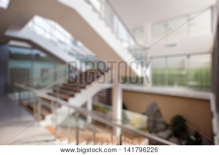 Blurred bokeh photo of stairs in office indoor hall