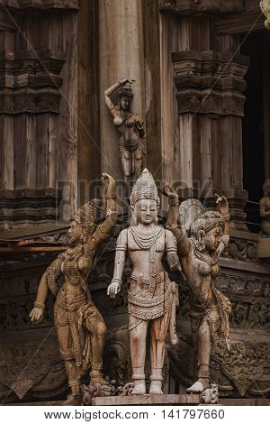 A historical buddhist temple constructed with reliefs woodcarvings. Sculptures on the monastery which is built by ancient civilizations. The gorgeous and unusual architecture looks eerie in Pattaya.