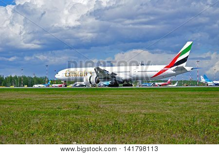 SAINT PETERSBURG RUSSIA-MAY 11 2016. Emirates Airline airplane. A6-EBY Emirates Airline Boeing 777 airplane after landing in Pulkovo airport. Emirates is an airline based in Dubai UAE.