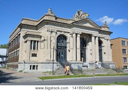 MONTREAL QUEBEC CANADA JULY 31 2016: Maisonneuve public bath and gymnasium was designed by architect Marius Dufresne, who created a number of other impressive public buildings in Maisonneuve.
