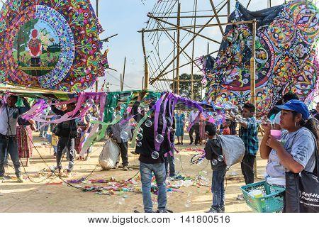 Sumpango, Guatemala - November 1 2015: Vendors, kite makers & visitors at giant kite festival on All Saints' Day honoring spirits of dead.