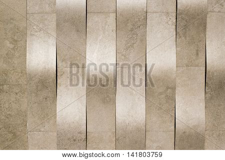 Exterior facade building wall detail geometric fabric texture background in pale brown tones.
