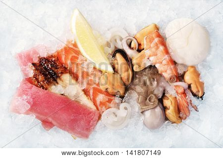 Seafood on crushed ice as a background