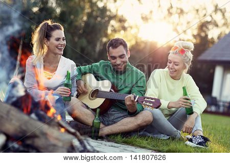 Picture showing group of friends having campfire