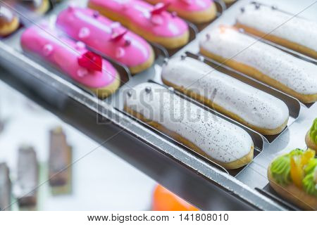Brightly colored cakes  in refrigerator