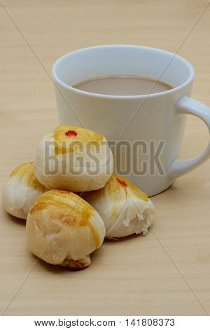 Cup Of Coffee And Four Chinese Pastry