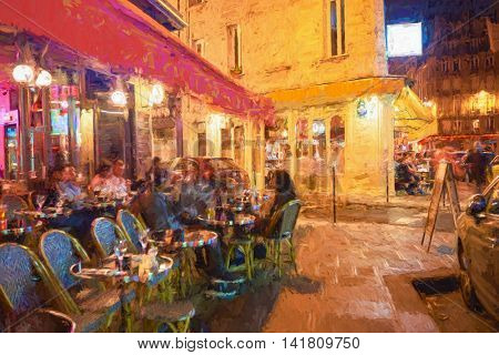 A cafe in Paris at night time.